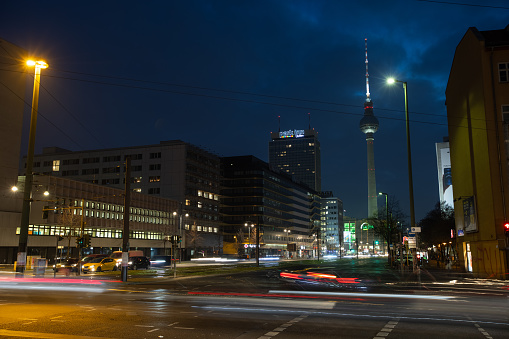 Light trails visible at a Berlin crossing in front of the famous TV tower fernsehturm
