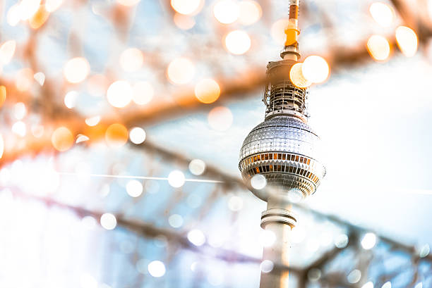 Berlin Tv-tower behind golden shining Christmas lights stock photo
