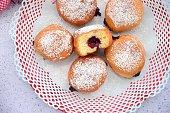 Berliner, German doughnut filled with strawberry jam