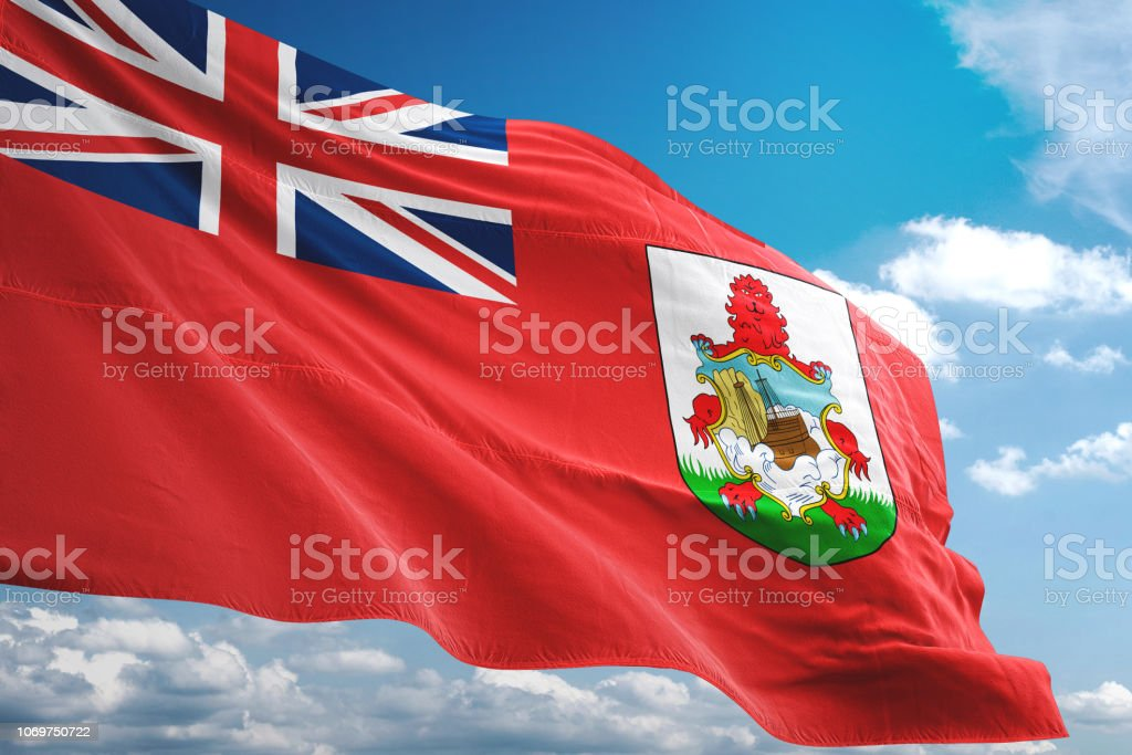 Bermuda flag waving cloudy sky background stock photo