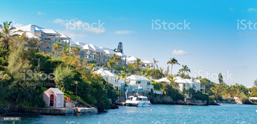 Bermuda waterfront with homes and pink ferry stop stock photo