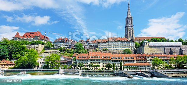 Panoramic view of Bern cityscape on a sunny summer day, Switzerland. Composite photo