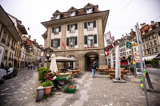 bern street in old town, switzerland - hotel bern stock-fotos und bilder