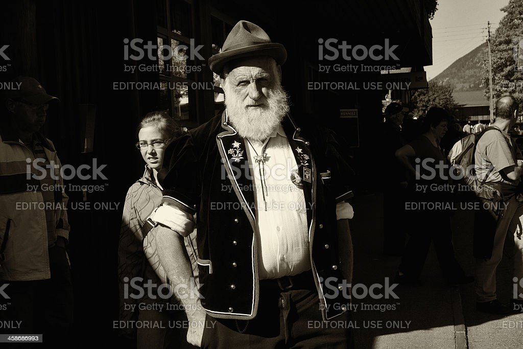 Bernese farmer stands with hands in pockets Aelplerfest Lenk stock photo