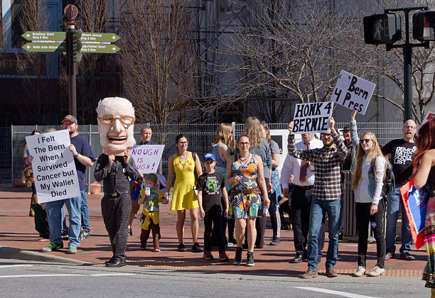 bernie sanders character stands with supporters in asheville - bernie sanders stok fotoğraflar ve resimler
