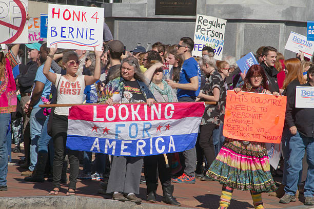 Bernie Sanders Surge of Support Asheville, North Carolina, USA - February 28, 2016:  Crowd of supporters at a Bernie Sanders rally hold signs and look for America in downtown Asheville, NC bernie sanders stock pictures, royalty-free photos & images