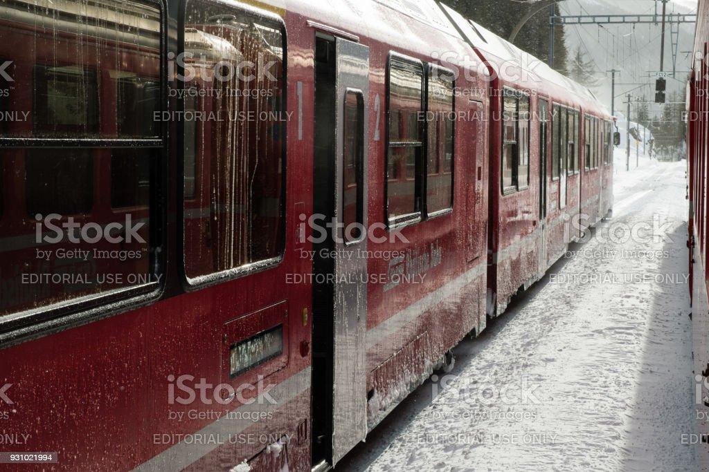 Bernina Express train carriages frozen stock photo