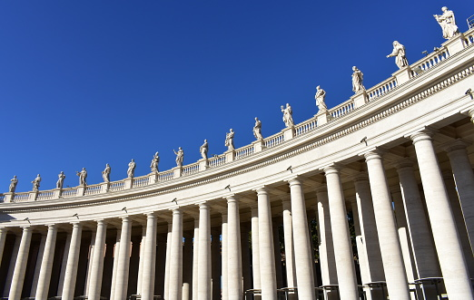Bernini's Colonnade and statues at St. Peter's Square. Vatican City, Rome, Italy.