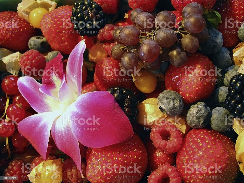 Berries and flower in farmers' market royalty-free stock photo