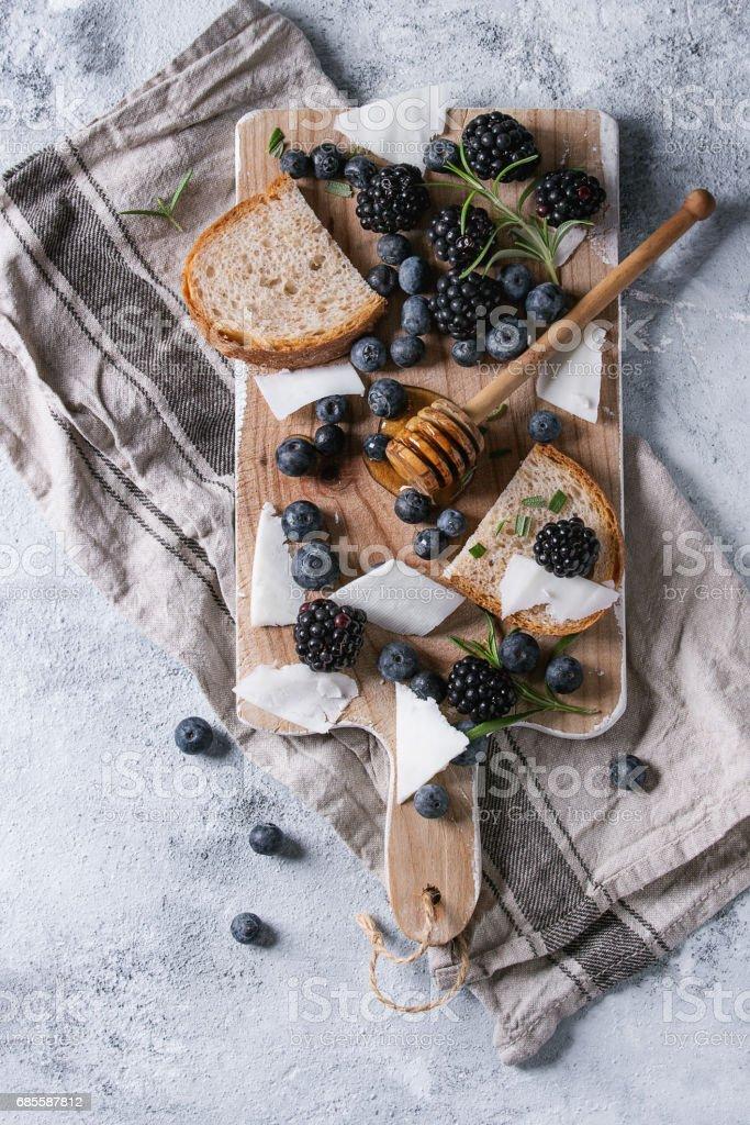 Berries, honey and rosemary 免版稅 stock photo