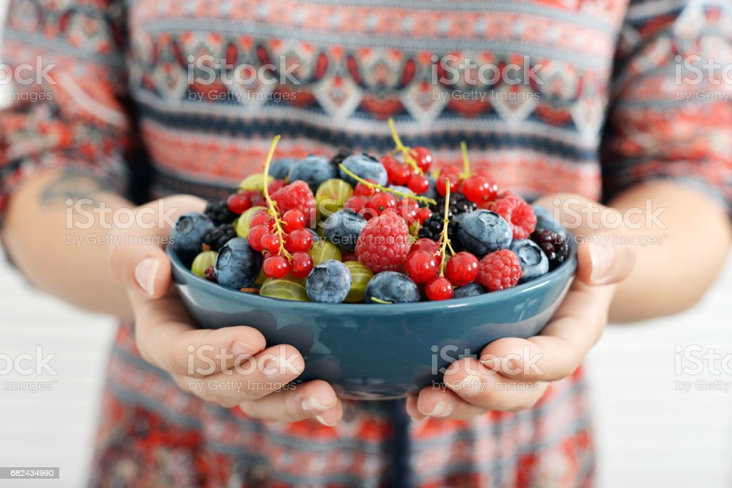 Berries in female hands royalty-free stock photo