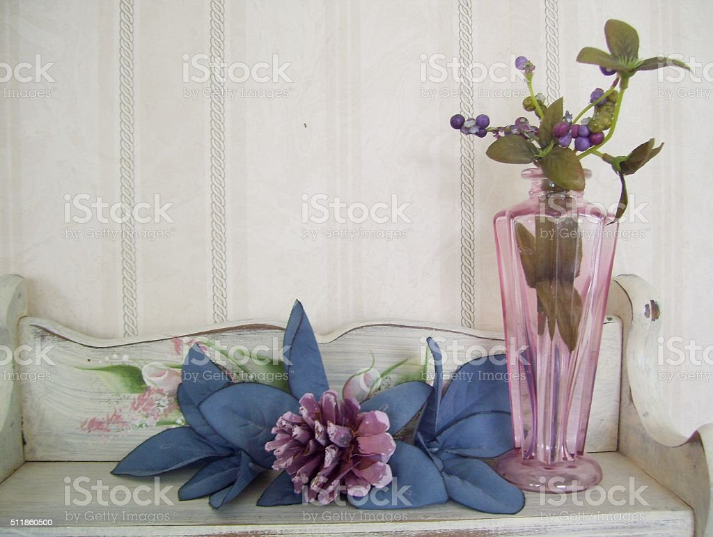 Berries in Glass Vase and Pine Cone on Wall Shelf royalty-free stock photo