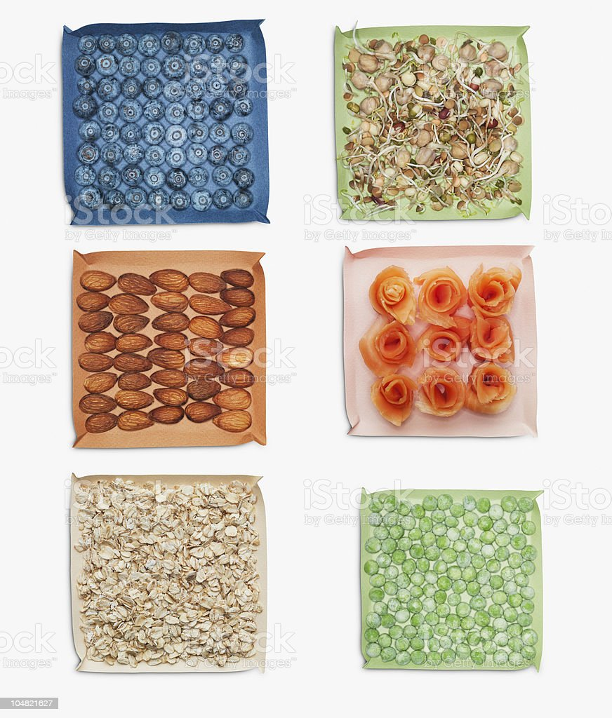 Berries, nuts, vegetables and herbs in dishes royalty-free stock photo