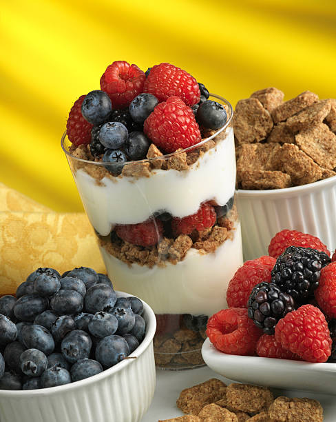 Berries, oat cereal and yogurt healthy parfait stock photo