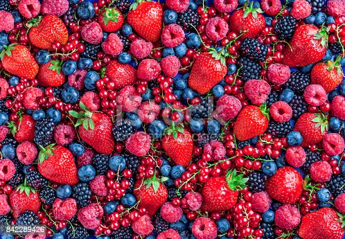 841659594 istock photo Berries overhead assorted large mix in studio on dark background 842289426