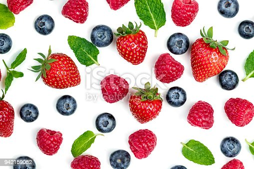942159066 istock photo Berries Pattern. Fresh berries isolated on white background, top view. Strawberry, Raspberry, Blueberry and Mint leaf, flat lay