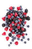 fresh forest fruits:  blueberries, rasberries and blackberries on white background
