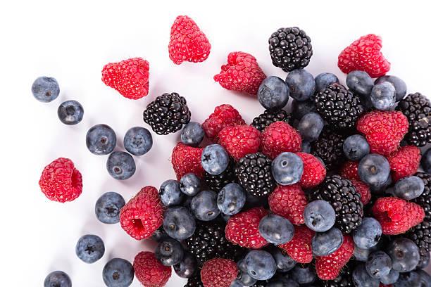 fruits rouges - fruit rouge photos et images de collection