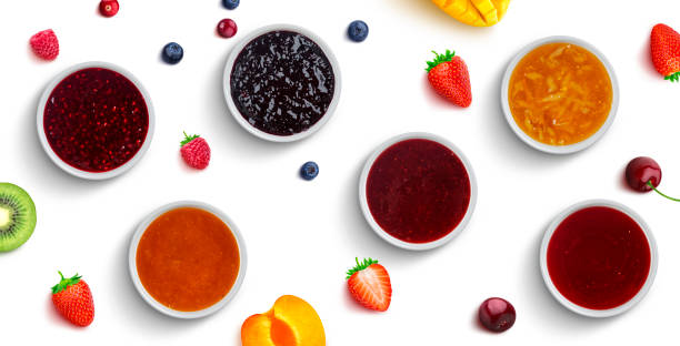 Berry and fruit jams isolated on white background, top view stock photo