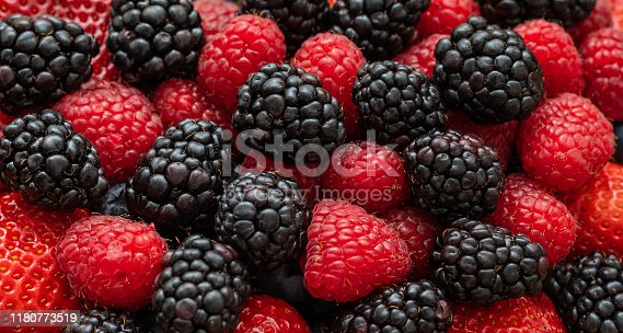 Berry background. Blackberries, raspberries and strawberries close-up, macro. Food background. Sweet fresh ripe berries mix. Berry pattern and texture.