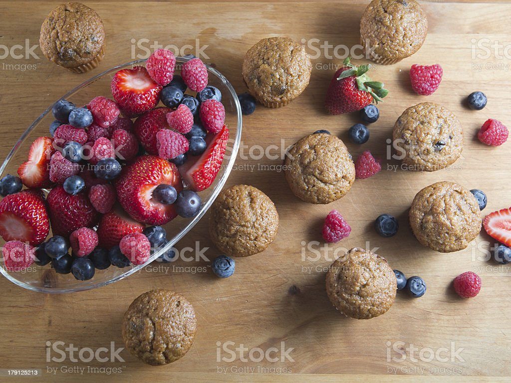 Berry Bran muffins and bowl of fruit royalty-free stock photo
