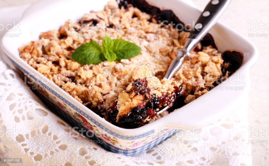 Berry crumble cake in a tin stock photo