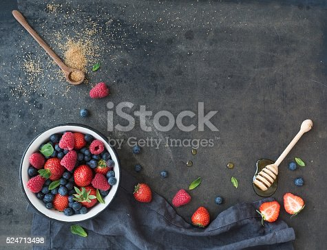 istock Berry frame with copy space on right. Strawberries, raspberries, blueberries 524713498