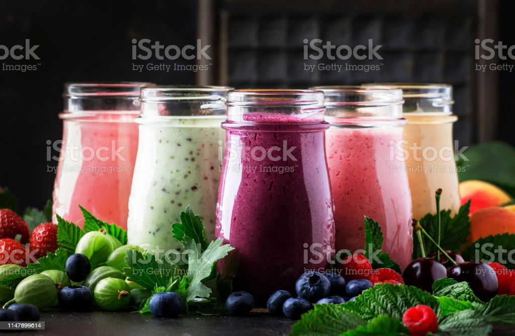 Berry fruit cocktails, smoothies and milkshakes, fresh fruit and berries on brown table, still life, selective focus Berry fruit cocktails, smoothies and milkshakes, fresh fruit and berries on brown table, still life, selective focus Apricot Stock Photo