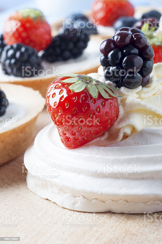 Berry Fruit Meringues and Tartlets royalty-free stock photo