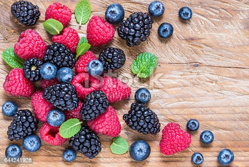 istock Berry fruits on wooden background. 644241928