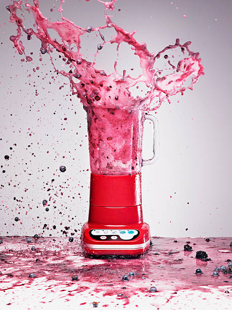 Berry juice splashing from blender  blender stock pictures, royalty-free photos & images
