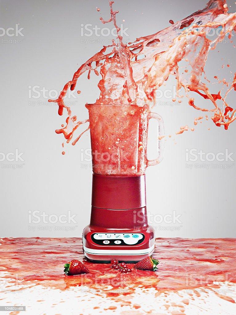 Berry juice splashing from blender stock photo