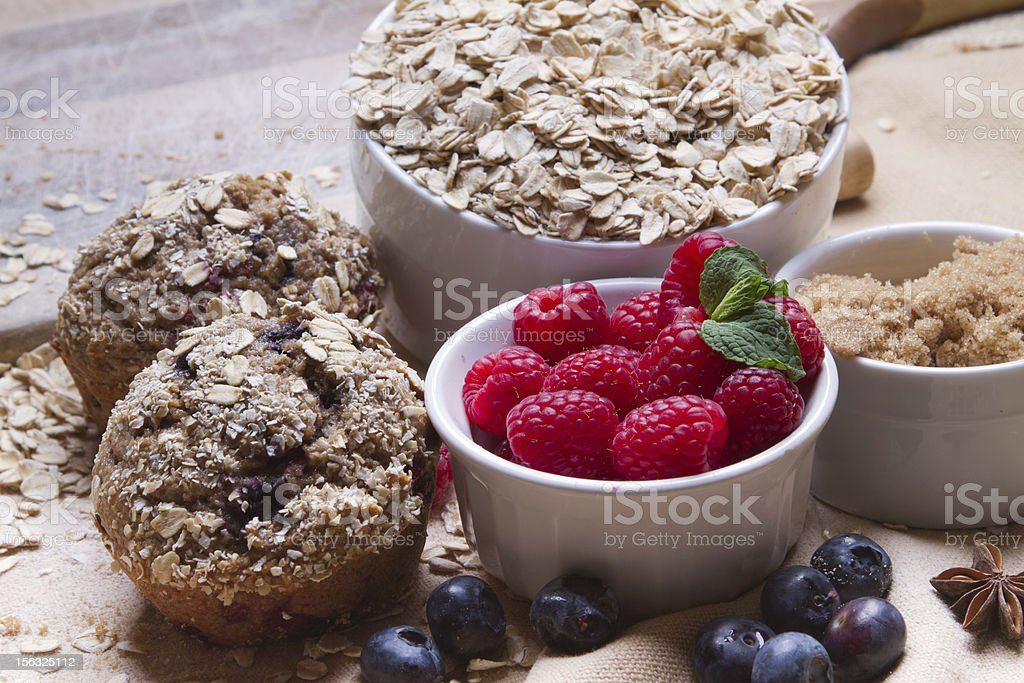 Berry Muffins Arranged with Fresh Ingredients royalty-free stock photo