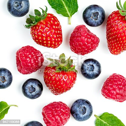 942159066 istock photo Berry Pattern. Fresh berries isolated on white background, top view. Strawberry, Raspberry, Blueberry and Mint leaf, flat lay