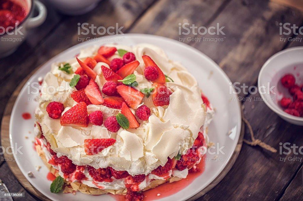 Berry Pavlova Cake with Strawberries and Raspberries stock photo