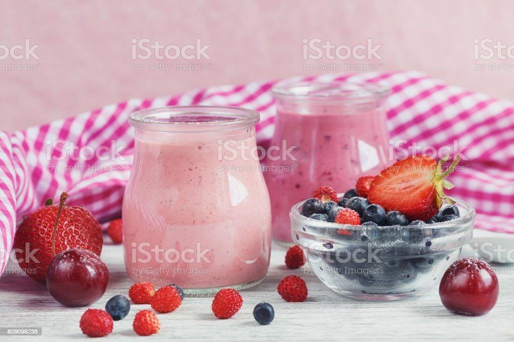Berry smoothie, healthy summer detox yogurt drink, diet or vegan food...
