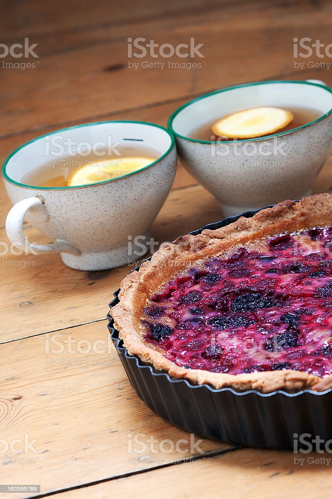 Berry Tart and Two Cups of tea stock photo