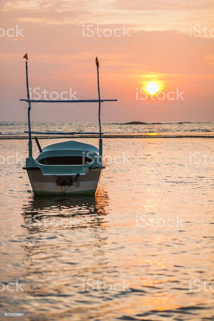Beruwala, SRI LANKA. Boat at sunset. stock photo
