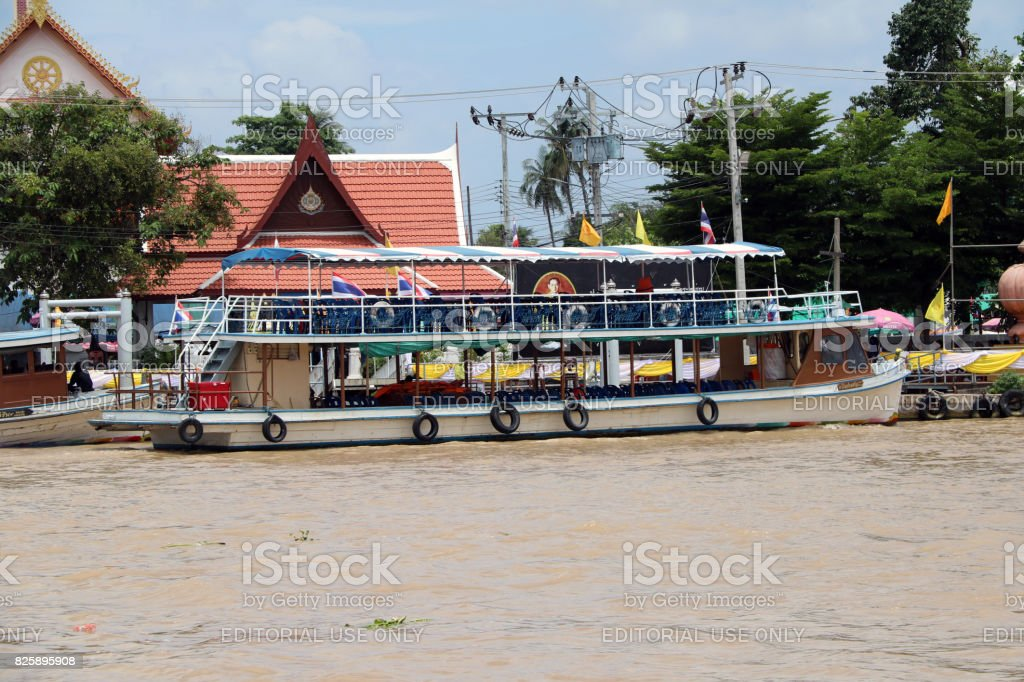 Beside of double decker passenger boat in Chao Phraya river. stock photo