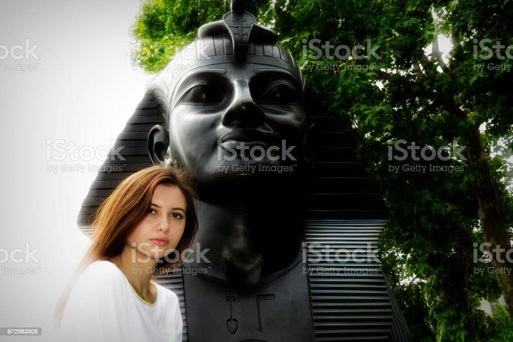 Beside the Sphinx pensive Bulgarian outdoor girl stock photo