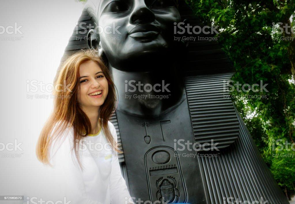 Beside the Sphinx smiling Bulgarian outdoor girl stock photo