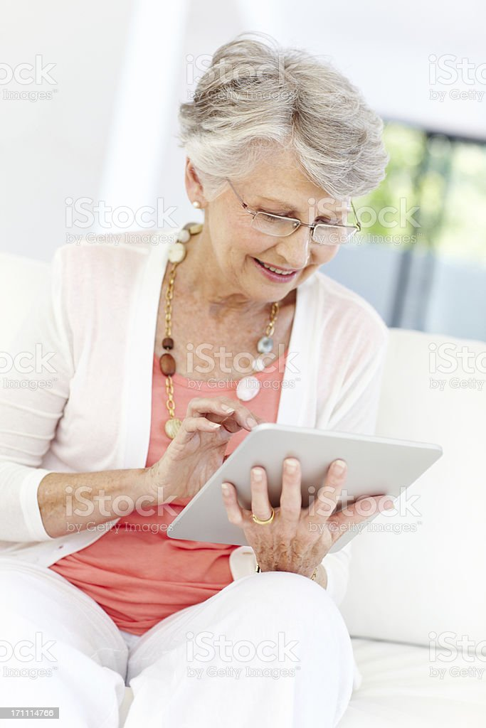 Bespectacled senior woman with tablet royalty-free stock photo