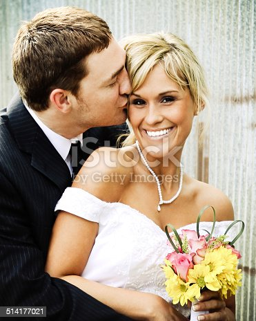 istock Best Bride and Groom Wedding Dress Kissing 514177021