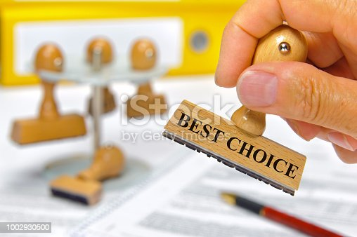 best choice printed on rubber stamp in hand