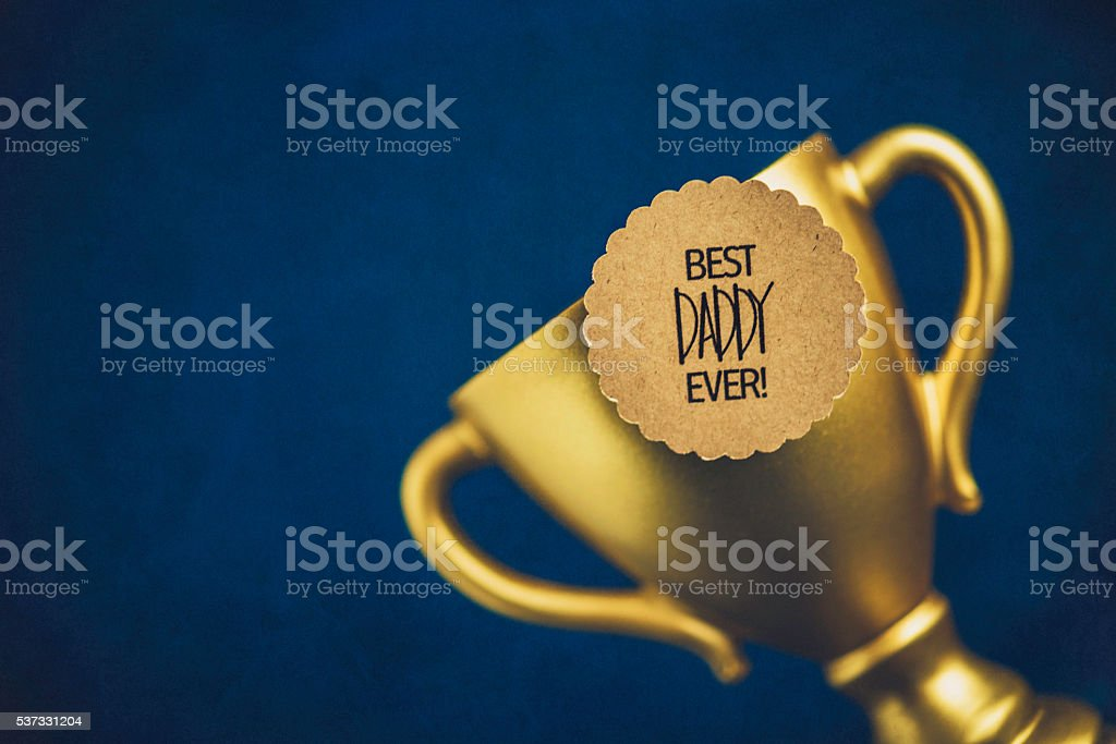 Best Daddy Ever Award with gold trophy. Father's Day stock photo