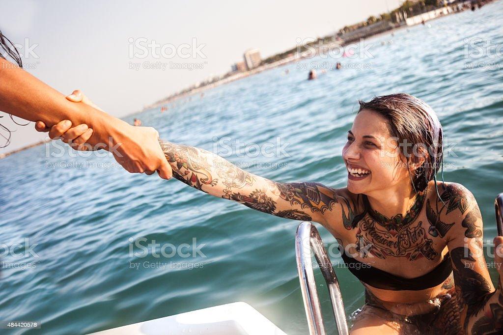 Best friend enjoying summer and pedalo fun stock photo