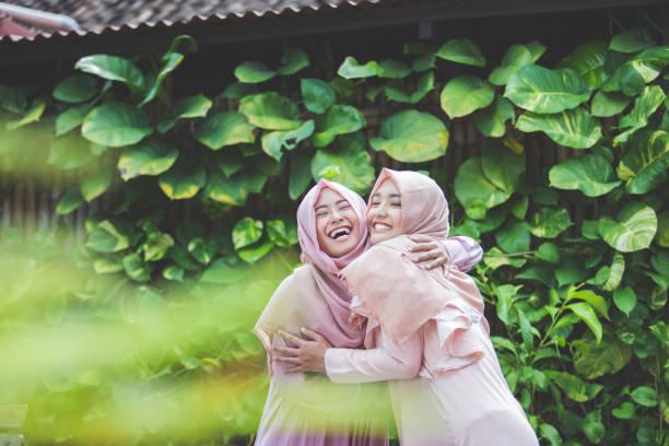 best friend hugs each other - kiss стоковые фото и изображения