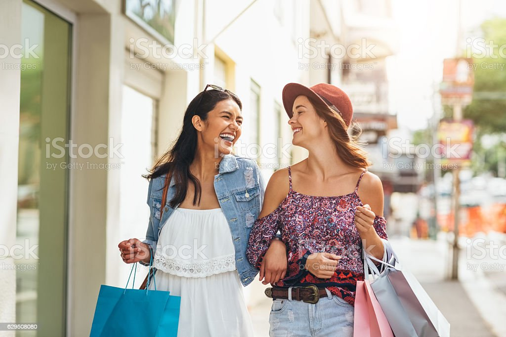 Best friend shopping frenzy stock photo