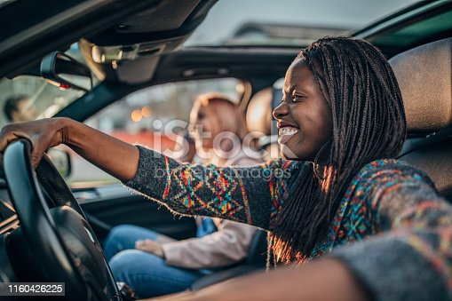 812419994 istock photo Best friends driving in a car 1160426225