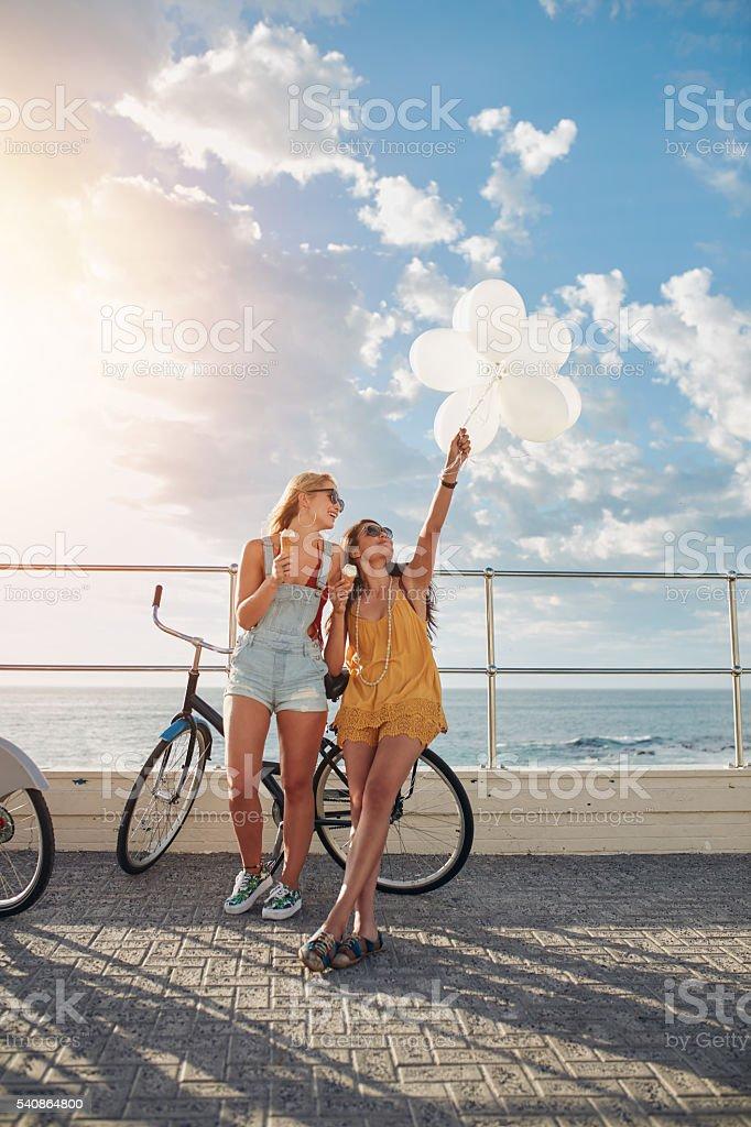 Best friends enjoying a day on seaside promenade - Photo